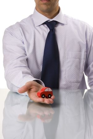 businessman selling a car (selective and soft focus) photo