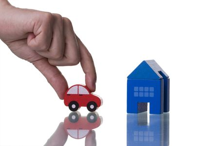 a hand showing a house and a car isolated with reflection photo