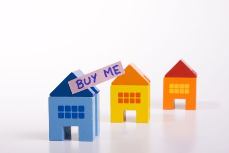 forsale: a toy house with a ad saying Buy Me