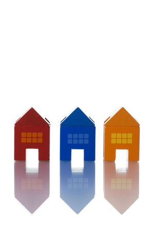 colorful toy houses isolated on white with reflection (selective and soft focus) Stock Photo - 3023836