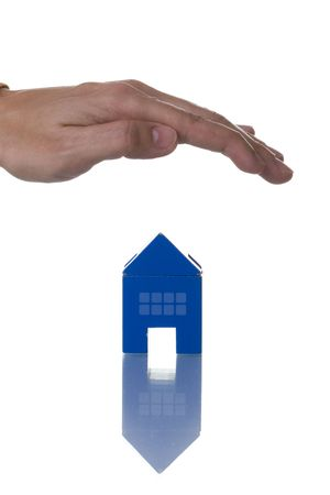 a hand over a house, conceptual protection (isolated on white with reflection) Stock Photo - 3023841