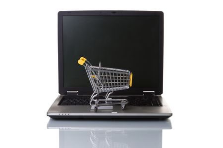 a laptop with a shopping-cart isolated on white with reflection Stock Photo - 3023846