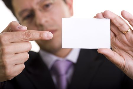Businessman showing is blank card with copyspace (selective and soft focus) Stock Photo - 3028724