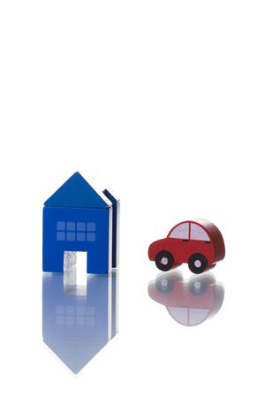 a house and car toy isolated on white with reflection photo