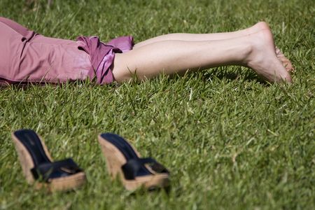 woman legs resting in the grass (selective and soft focus) Stock Photo - 3069878