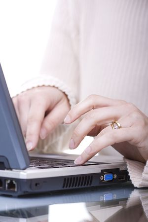 woman typing on her laptop (selective ans soft focus) Stock Photo - 3069832