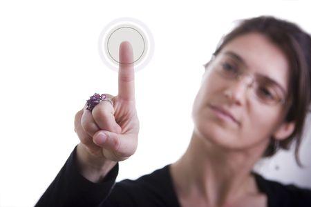 initiate: a businesswoman pressing a hi-tech button
