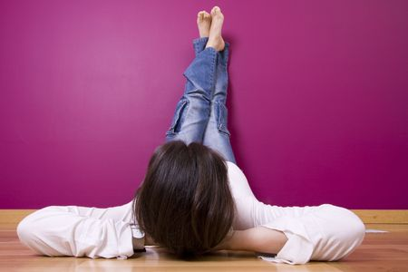 woman relaxing, looking a t her new painted wall (focus on the head) photo