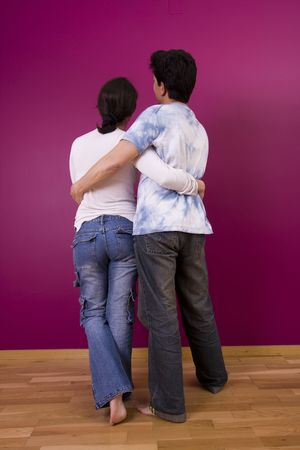 Couple looking to the new painted wall Stock Photo - 3069873