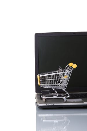 a laptop with a shopping-cart isolated on white with reflection Stock Photo - 3118702