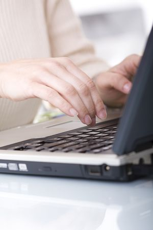 woman typing on her laptop (selective ans soft focus) Stock Photo - 3118696