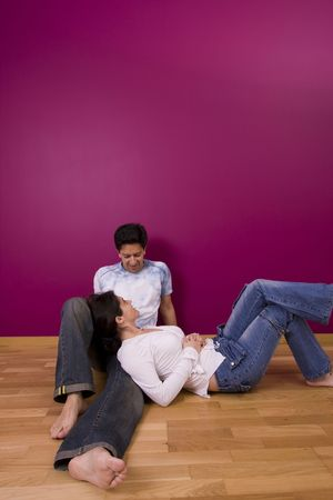 Couple enjoying the new painted wall Stock Photo - 3128494