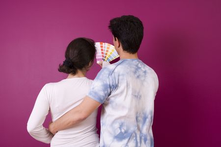 Couple looking to the new painted wall Stock Photo - 3145519