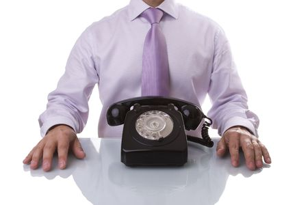 businessman waiting call: businessman at the office waiting for a call