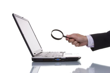 businessman finding data in a laptop photo