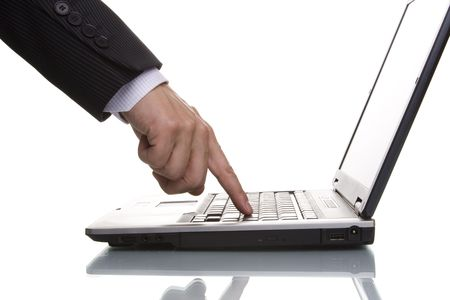 enter key: businessman pressing the enter key on a laptop