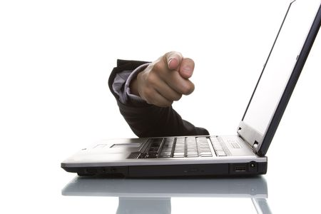 businessman hand pointing to you over a laptop photo