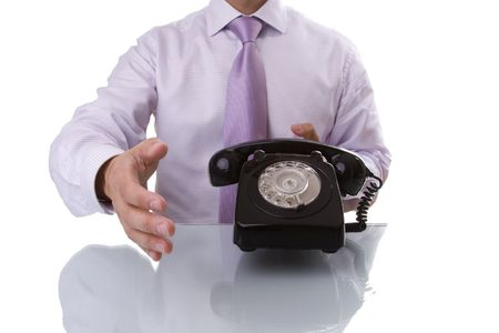 businessman with a old telephone making a communication deal photo