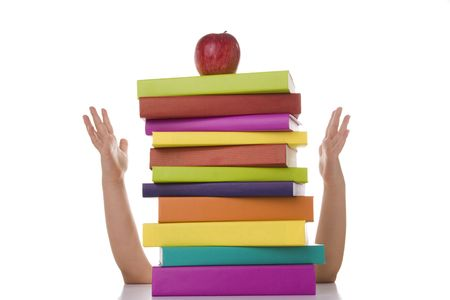 a stack of books with a apple on the top  (selective focus) photo