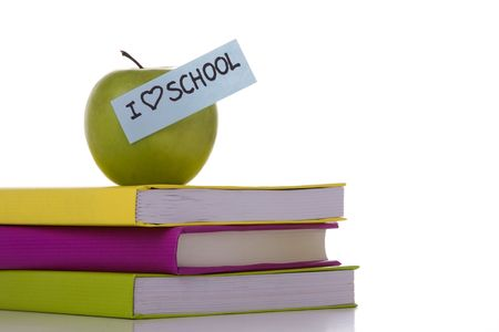 a stack of books with a apple on the top  (selective focus) Stock Photo - 3473278