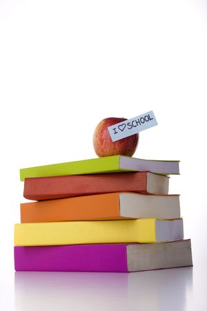 a stack of books with a apple on the top Stock Photo - 3473332