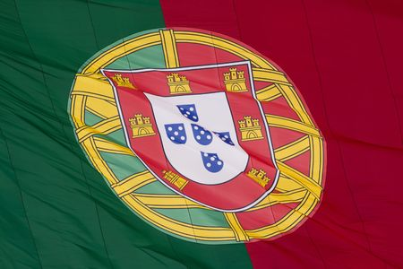 a portuguese flag blowing with the wind photo
