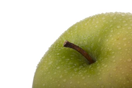 detail of a fresh and wet golden apple photo