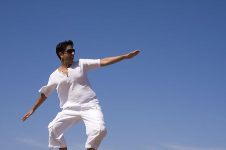 young men dress in white surfing de sky Stock Photo - 3518178