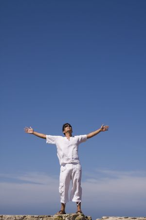young men dress in white with the blue sky as background Stock Photo - 3540295