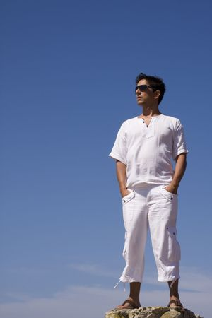 young men dress in white with the blue sky as background Stock Photo - 3540298