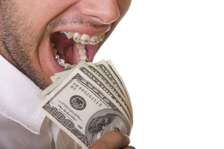mouth with braces on the teeth eating money (isolated on withe) Stock Photo