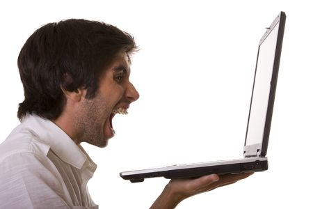 one young men screaming with his computer (isolated on white) Stock Photo - 3632082