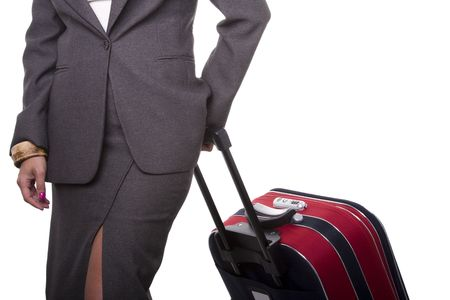 young leave: a detail of a businesswoman pushing her baggage