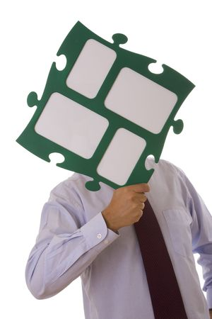 businessman holding a big puzzle piece with copy space (isolated on white) Stock Photo - 3702129