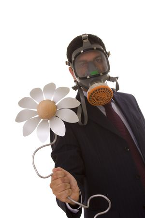 a businessman with a gas mask holding a flower from the future (selective focus) photo