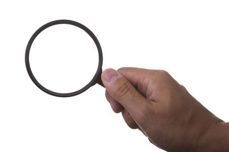 hand holding a magnifier glass (isolated on white) Stock Photo - 3724869
