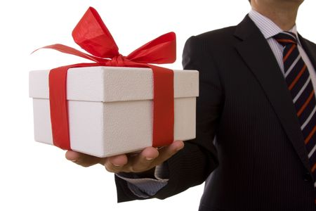 a businessman offering a gift to you (selective focus) photo