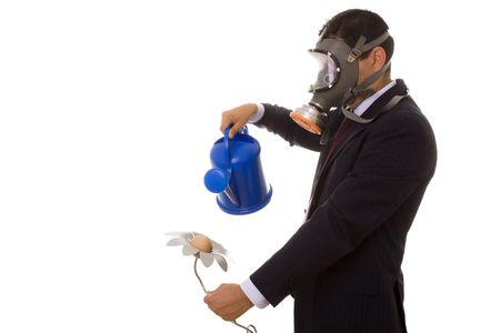 a businessman with a gas mask holding a articial flower from the future  photo