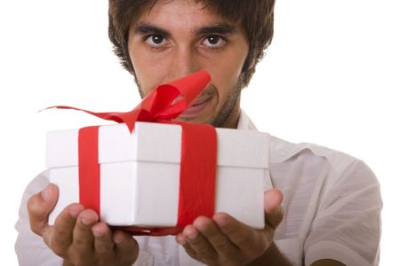 young man with a wrapped gift box for you (selective focus) photo