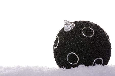 black christmas ball in the snow (selective focus) Stock Photo - 3845056