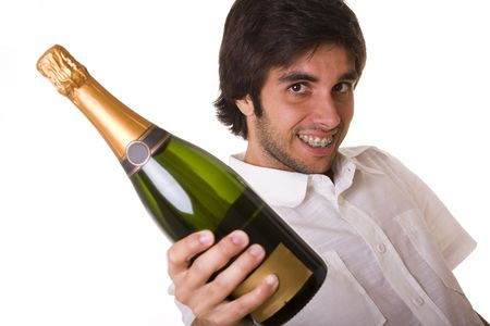 man ready to open a bottle of champagne in the new year eve  (selective focus) photo