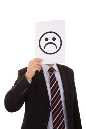 businessman hiding behind a paper with a sad face symbol photo