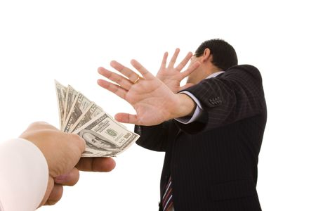 a uncorrupt businessmen refusing money from a bribe (selective focus) Stock Photo - 3903495