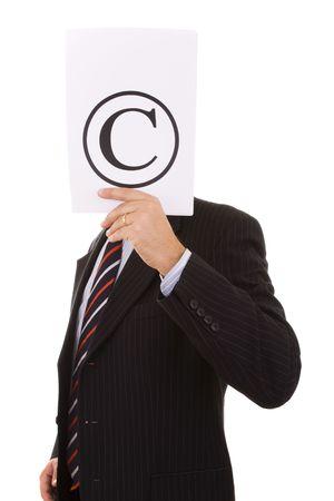 file clerk: businessman hiding behind the copyright symbol