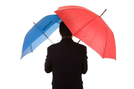 a insurance agent businessman holding two umbrellas for best protection Stock Photo - 3950213