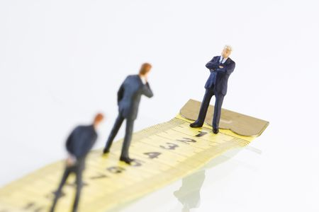 miniature businessman in some kind of competition (selective and soft focus) photo