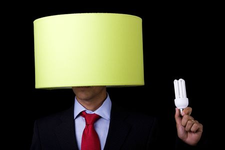plagiarism: businessman holding a lamp (its not his idea) Stock Photo