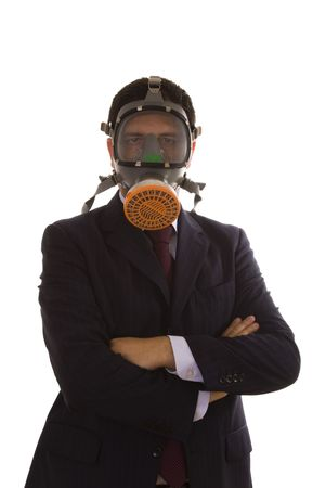 businessman with a gas mask and crossed arms (selective focus) photo