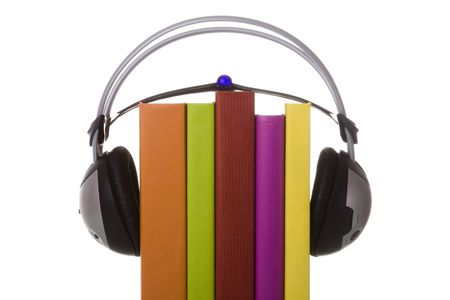 colorful audiobook concept with headphones and books (isolated on white) photo