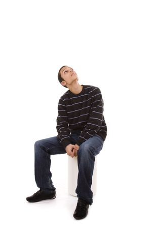 young man seated in a bench looking up to the copy space